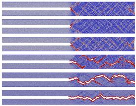 Modelling how fracturing metallic glass releases energy at the atomic level