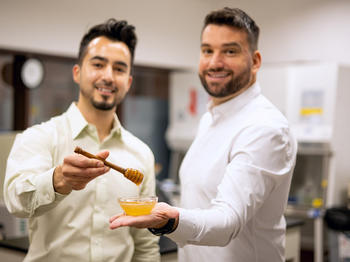 MeliBio Co-Founders: Aaron Schaller, PhD and Darko Mandich holding prototypes of MeliBio honey made without bees